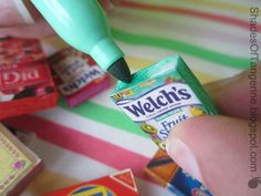Use images from ads/coupons to create dollhouse food packages.