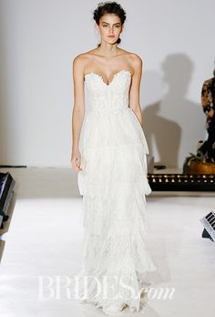 Brides.com: . Style 3659, ivory Chantilly lace tiered A-line gown over nuder sparkle net and cashmere chiffon, Venice lace appliqué accent bodice, strapless sweetheart neckline, natural waist, layered Chantilly lace skirt, Lazaro