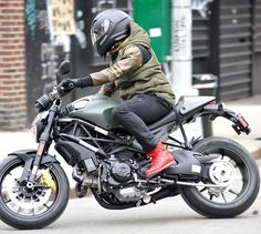 Pop superstar Usher was seen driving away from a store, all smiles, on his Ducati bike in New York, New York on March 2, 2013.