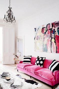 Not really loving the pink but like a colored sofa with the black cow rug