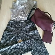 Sleek look and feel pants, size S Grey silver and black colors, cheetah print pants, spice up your evening attire with these pants, very stretchy and comfy, 90% polyester / 10% spandex, excellent condition, 2 back pockets but no front pockets Pants Ankle & Cropped