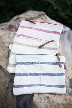 Linen Pouch A fun twist to our classic laundered linen are these pouches. With colors like indigo, red and taupe, our McKenzie bags are versatile enough for everyday use. Equally stylish and functional...great as a makeup bag or on-the-go as a travel bag.
