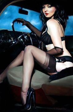 Raven haired beauty in black lingerie in a classic car