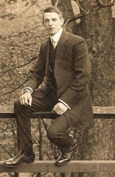 Edwardian man sitting on fence by pepandtim, via Flickr