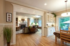 open concept, doorway trim, hardwood floors - love it all