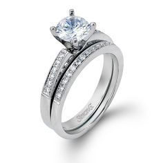Classy Collection - This gorgeous 18K white engagement ring and band is comprised of .17ctw round white Diamonds. - LP1460