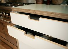 Detail of grab handle drawer fronts made for North London kitchen