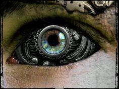 A steampunk cyborg. Steampunk Wallpaper, Steampunk Artwork, Eyes Wallpaper, Artistic Wallpaper, Fabric Wallpaper, Creation Art, Fotografia Macro, Eye Art, Dieselpunk