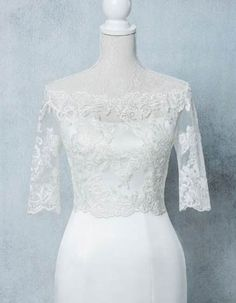 bridal  lace jacket with 3/4 sleeves and a beautiful button back