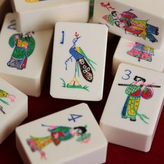 Solid ivory mahjong tiles, mid 20th century. The tiles were wrapped in cellphone and unused as to their white appearance and bright paint colors. Mah Jongg.