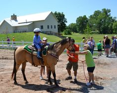 Special needs kids from Wichita and the surrounding areas attend the first Dilly's Place Family Fun Day at Camp Hyde., #examinercom