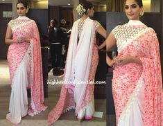 Wearing a custom Abu Jani Sandeep Khosla sari, Sonam attended a ceremony felicitating last year's kids that won the National Bravery Awards. You've probably already noticed that the sari has a twist in the sense that it had another pallu, one that went around the neck like a scarf. Hair in an updo complete with a tube rose gajra, her sari look was finished out with Amrapali earrings and Apala By Sumit rings.