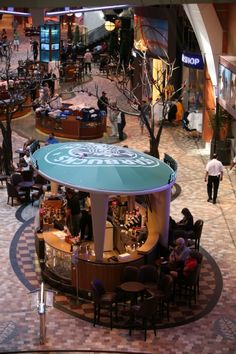 Allure Of The Seas - Royal Promenade with the first ever Starbucks on a cruise ship.
