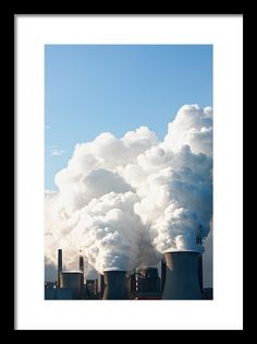 Air Pollution Framed Print featuring the photograph Power Station Plumes. by Jan Brons. Hugh plumes out of the chimneys of coal power station reaching for the blue skies.