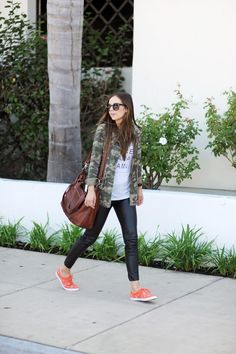camo jacket, graphic tee, leather leggings, brightly colored sneakers