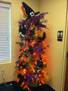 Quite an amazing Halloween tree in an office. Want some tips on surviving the office Halloween party? Here you go: http://www.livecareer.com/news/Job-Trends/How-to-Survive-Your-Halloween-Office-Party_$$03190.aspx