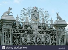 Wrought Iron Gates Entrance Chirk Castle near Wexham North Wales UK Europe Family Crest National Trust Stock Photo Wales Uk, North Wales, Fence Lighting, Wrought Iron Gates, Uk Europe, Entrance Gates, Family Crest, National Trust, Illustration Art