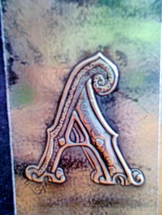 Embossed personalised letter on book