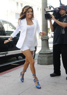Eva in a white suite with her blue stilettos.