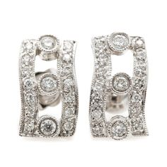 12c1f82d9 Item Details A pair of 18K white gold diamond earrings. This pair of drop  earrings. EBTH