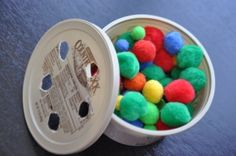 Great fine motor skill activity! Just cut small holes in a butter container lid and give kids pom poms to push through.