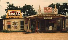 A cross roads store, bar, juke joint, and gas station in Melrose, Louisiana, 1944, by Marion Post Wolcott, FSA/OWI