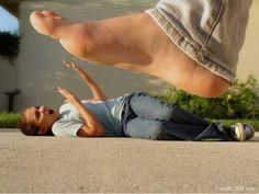 BIG FOOT http://www.smosh.com/smosh-pit/photos/25-amazing-forced-perspective-illusions