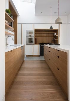 Love the way this floor was laid in such a small space. Makes it seem wider. Perpendicular Wood Floor, Remodelista