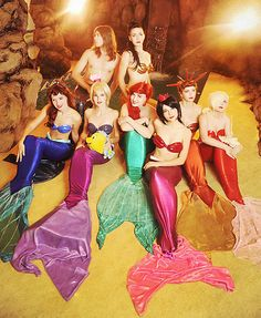 Ariel And Sisters Mermaid Cosplay!  This is really good!  And I just wanna know... what's with the random guy??  I don't remember him...
