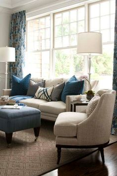 foundation of the room is neutral, color comes from curtains, pillows and ottoman