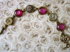 1800s antique Victorian button bracelet with floral buttons and handmade dichroic glass cabochons, by SewSandyShop, $36.00