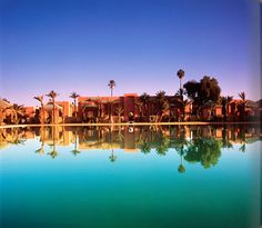 """Amanjena (""""peaceful paradise"""") is the first Amanresort on the African continent. The resort's 32 pavilions, six, two-storey maisons and largest accommodation, the Al-Hamra Maison, are set within an oasis of palms and mature olive trees."""