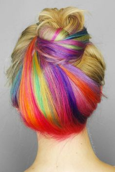 Give the unicorn hair trend a try with a subtle rainbow under-dye in tie-dye brights.