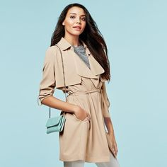 Who says you need structure? This season, the coolest coats are all about slouch, with silhouettes that drape and express that effortless chicness every girl craves. Get fashionable with this drape trench coat.
