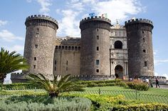 Castel Nuovo, Naples    Visitors who arrive in Naples by boat are greeted by the turrets, crenellated parapets, deep moat, and overall storybook appearance of this massive 13th- century fortress overlooking the bay.    Photo Caption: The incongruous triumphal arch was squeezed in between the 13th-century turrets of the Castel Nuovo in the mid-1400s.    Photo by Raffaele Capasso