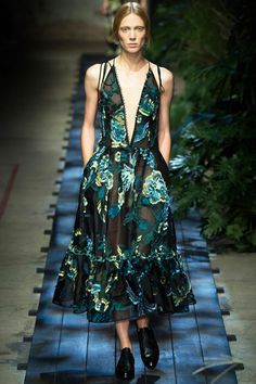 The tiny buttons trailing the deep neckline of this gorgeously embroidered dress. Erdem Spring 2015 RTW. #lfw #Erdem #spring2015
