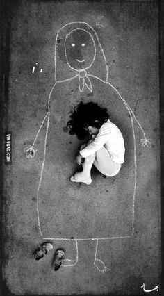 An Iraqi girl in an orphanage - missing her mother, so she drew her and fell asleep inside her. Very sad... What do you see in your eyes now..?