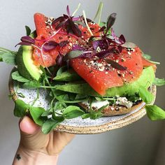 @urbankitchenapothecary pulls together a thoroughly awesome power lunch no? . .toasted grain-free everything bagel with a schmear of @kitehillfoods chive almond cheese @windfallfarms pea shoots  amaranth microgreens avo smoked wild Alaskan salmon  her everything gomasio . . .get this plate at oguskyceramics.etsy.com..... . . . . . . . . #simplefood #beautifulcuisines #hautecuisines #lunch #grainfree #glutenfree #dairyfree #paleo #foodgawker #foodstagram #foodandwine #eattherainbow #jerf…