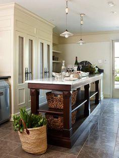 Long kitchen island offers multilevel shelving.