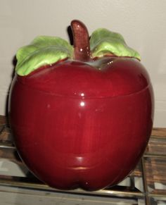 Apple Cookie Jar...my granny had a metal apple cookie jar and man you couldn't sneak a cookie to save your life...hahahaha