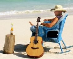 Kenny Chesney in his old blue chair ... sippin' corona... what's not hot about that?