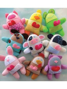 Nine Spring Felt Animal Softies - These adorable animals are stitched entirely by hand, using a whip stitch around the felt edges and straight stitches for details on the faces. Instructions are included to make a pig, chick, frog, dog, cow, sheep, bunny, chicken and cat.