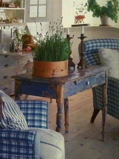Distressed table in blue... love the plant container too!