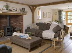 Just Goes To Show You Don T Need Clutter Get The Country Cottage Living Room Feel A Really Comfy Sofa Some Woodwork And Fireplace