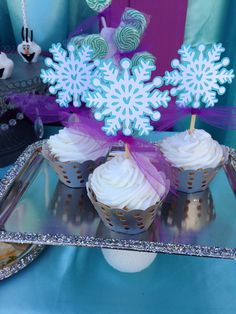 Gorgeous snowflake topped cupcakes at a Frozen Movie Night Party!  See more party ideas at CatchMyParty.com!