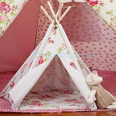 $30  Mini Teepees  these are tiny one for toys.  but i think a small child would fit in it :)