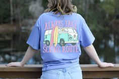 Dreaming of a road trip to the beach! ☀️ Always Take the Scenic Route by Southern Girl Prep.  Shop our new lavender beach style short sleeve tshirt with a VW van and surf board design. Made of cotton and comes in youth and adult.