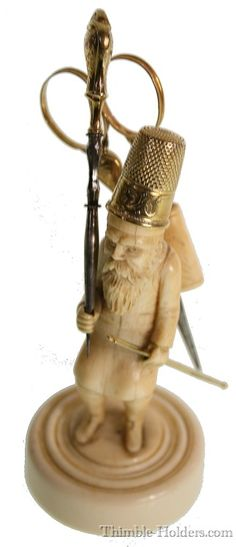 Thimble and sewing accessory holder: Carved ivory standing Russian figure, bearing French gold tools, Unknown origin. Early 19th century.