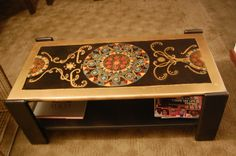 the new face of an old table, hand-painted
