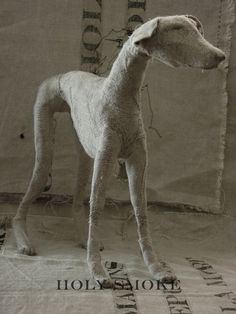 Helen Thompson aka Holy Smoke creates these expressive canines from wire, natural linen, and vintage textiles.
